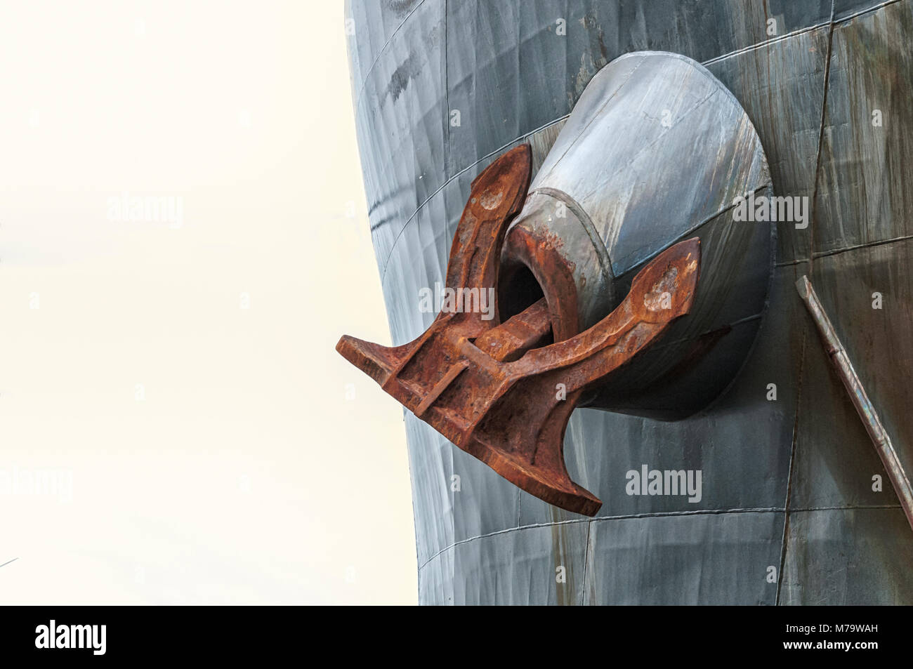 a huge ship's anchor hanging from a tanker Stock Photo
