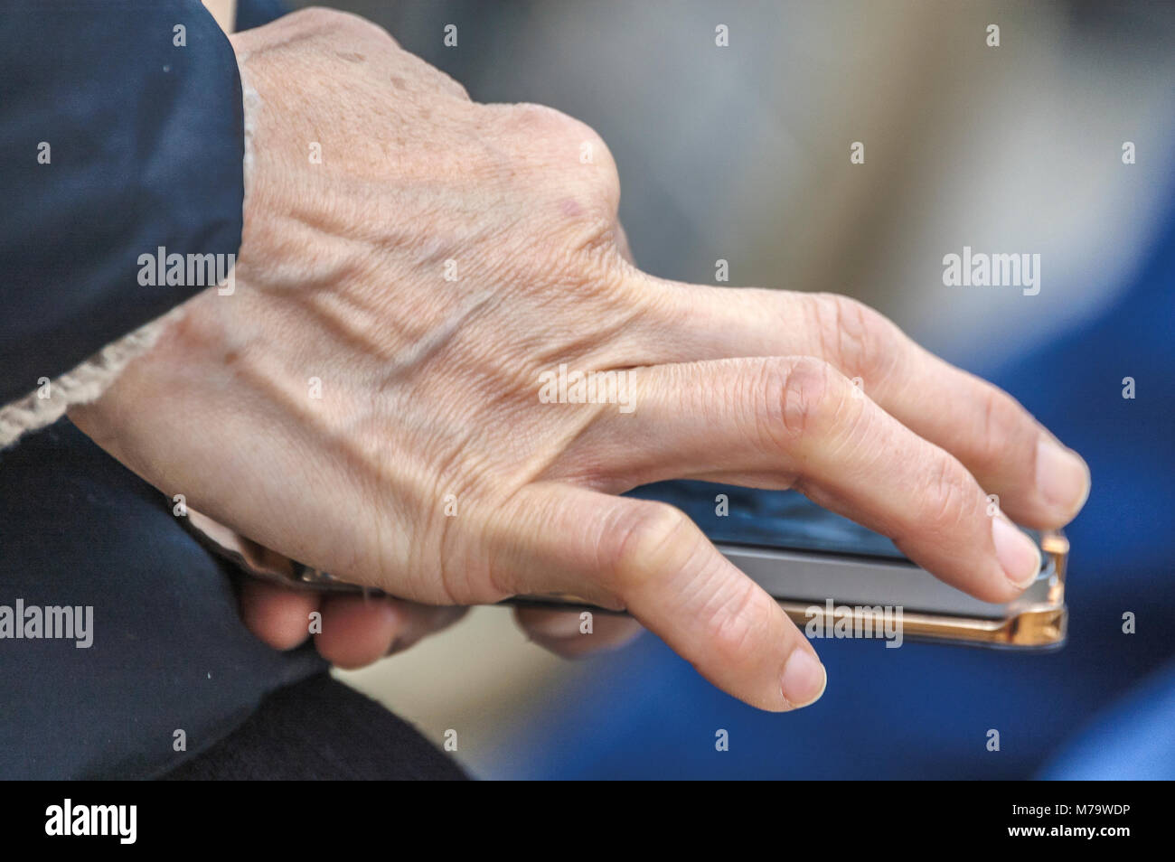 human hand touching a mobile phone Stock Photo