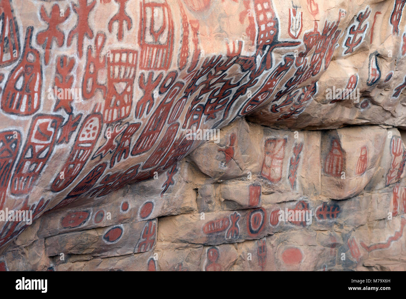 Tribal art in the form of cave painting at a traditional circumcision site. Dogon country, Mali, West Africa. - Stock Image