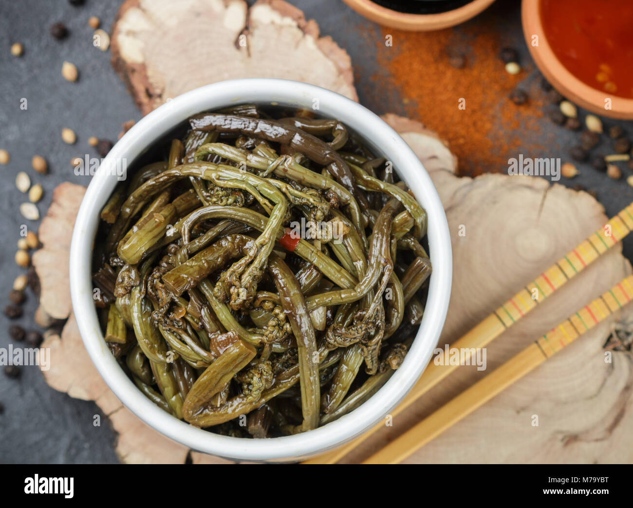Spicy salad of fern with onion, garlic, soy sauce and spices. Dish Eastern and Asian cuisine. Selective focus - Stock Image