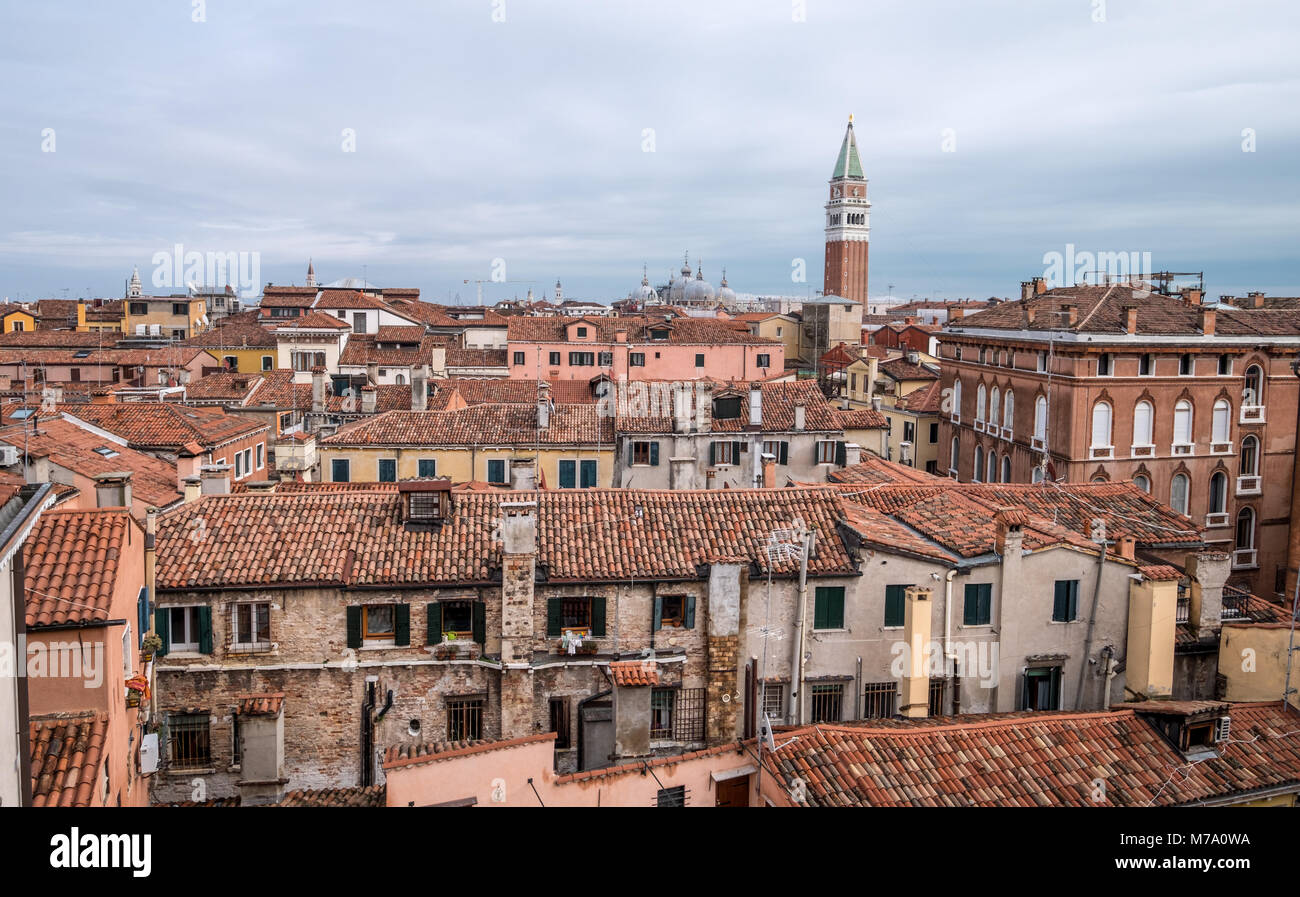 Panoramic view from the top of the spiral staircase at Palazzo Contarini del Bovolo, Venice, Italy showing rooftops - Stock Image