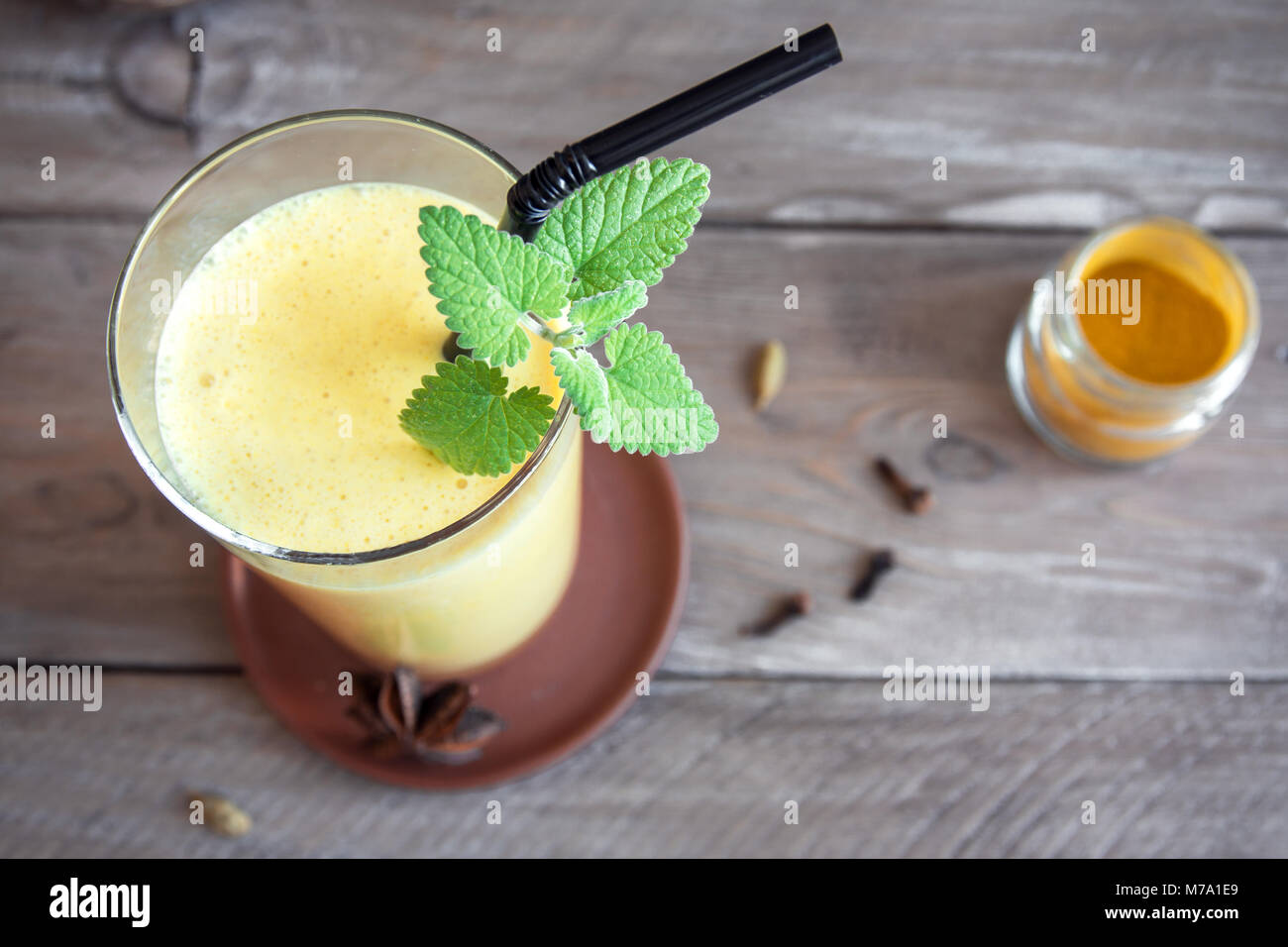 Turmeric Lassie or lassi in glass - Healthy Probiotic Indian cold drink made up of curd (yogurt), milk, spices and - Stock Image