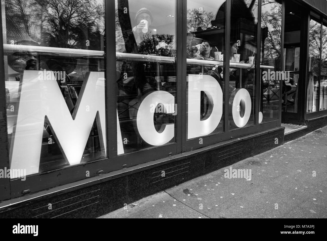 Paris, France - January 7, 2018: Typical glass facade of a fast food restaurant in the center of Paris. - Stock Image