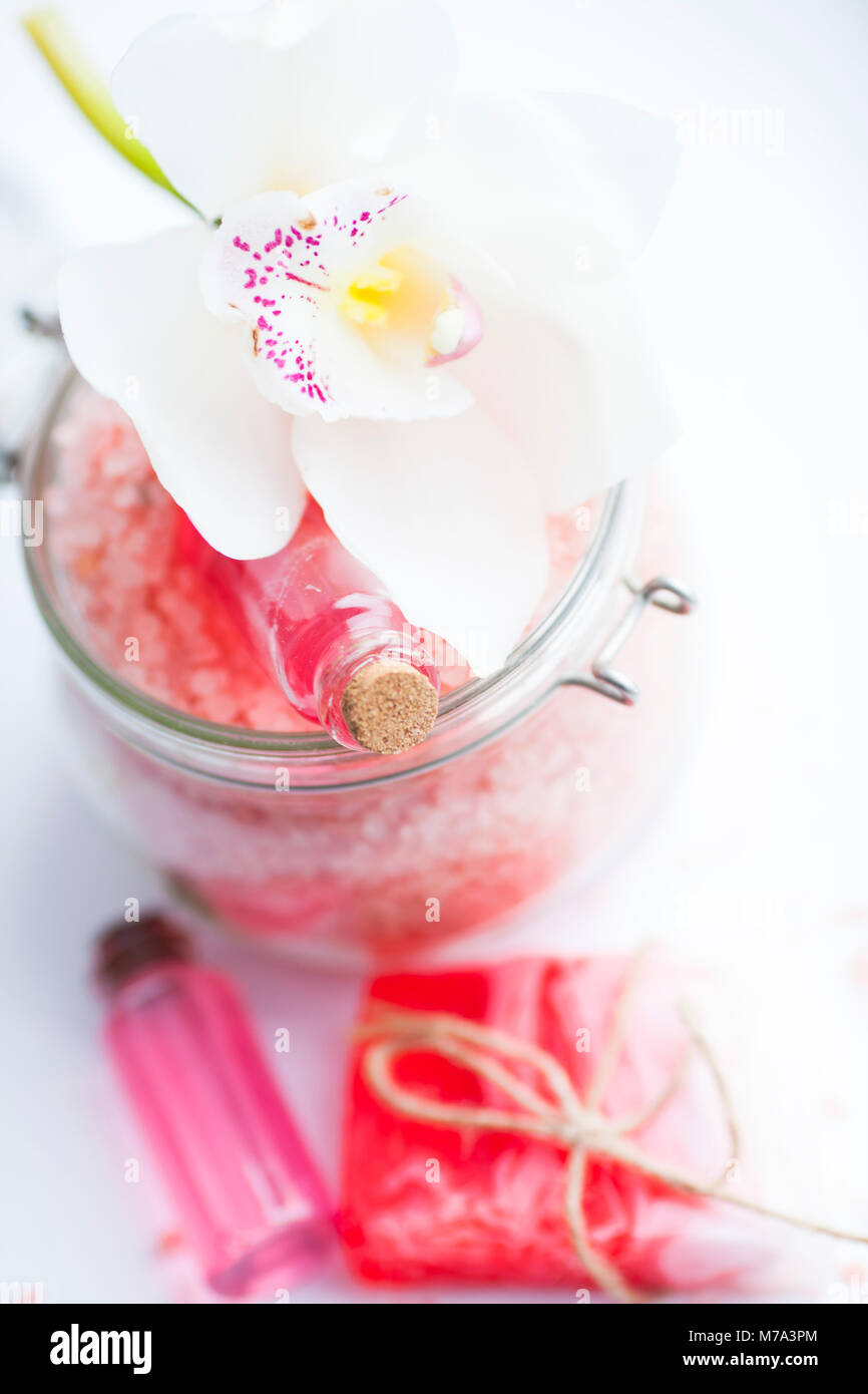 Spa and natural cosmetics concept. Set of sea salt, orchid, natural clay ,shea oil, glass bottles and other spa Stock Photo