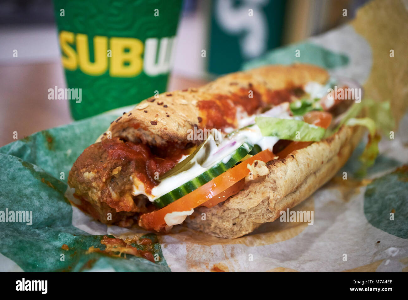 Subway six inch meatball marinara sandwich in the uk with coffee - Stock Image