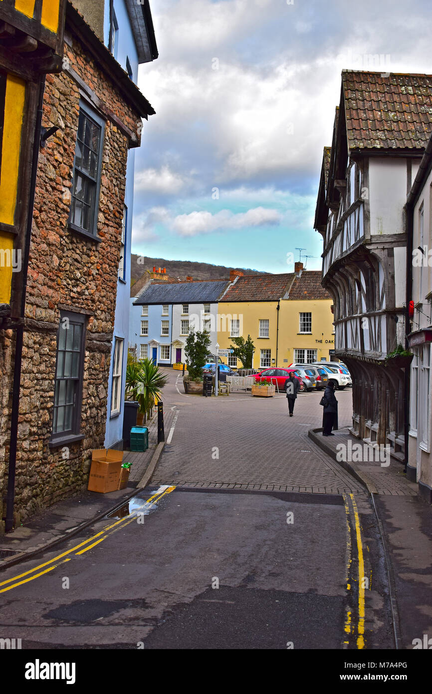 Old buildings leading to the medieval square in the centre of Axbridge. The overhanging b/w building on the right - Stock Image