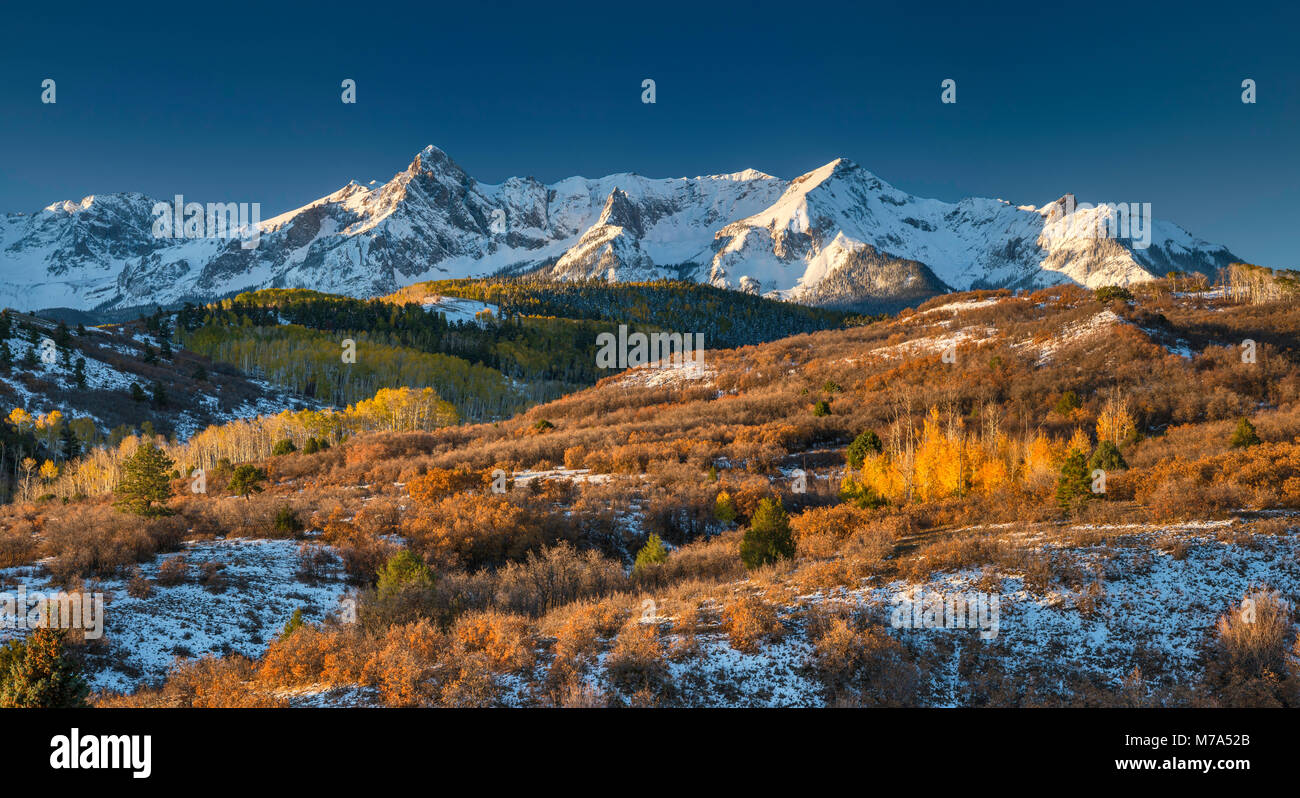 North Pole Peak and Hayden Peak in Sneffels Range, under snow in late fall, view at sunrise from San Juan Skyway - Stock Image
