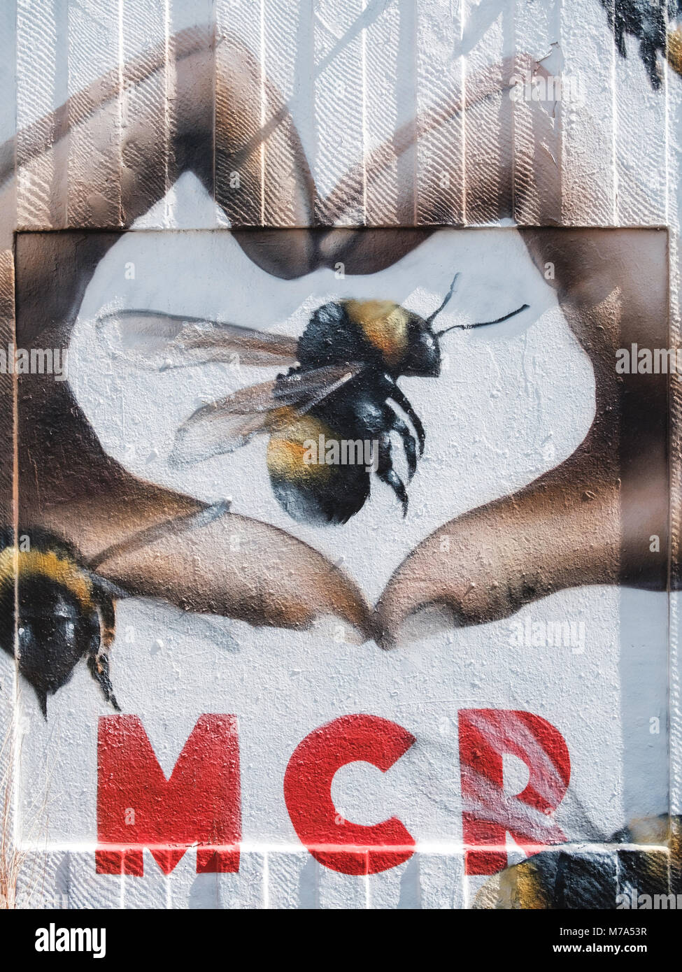 Street art in Manchester's Northern Quarter. The Love MCR design is part of the response to the terrorist attack Stock Photo