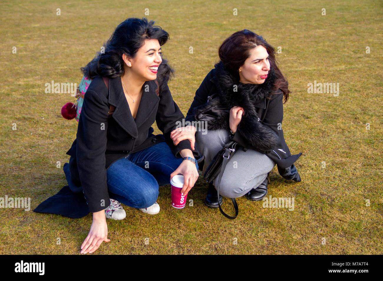 Two female students, Parisian-Algerian Faiza Faa (left) and her friend Samar Munaf from Iraq (right) having fun Stock Photo