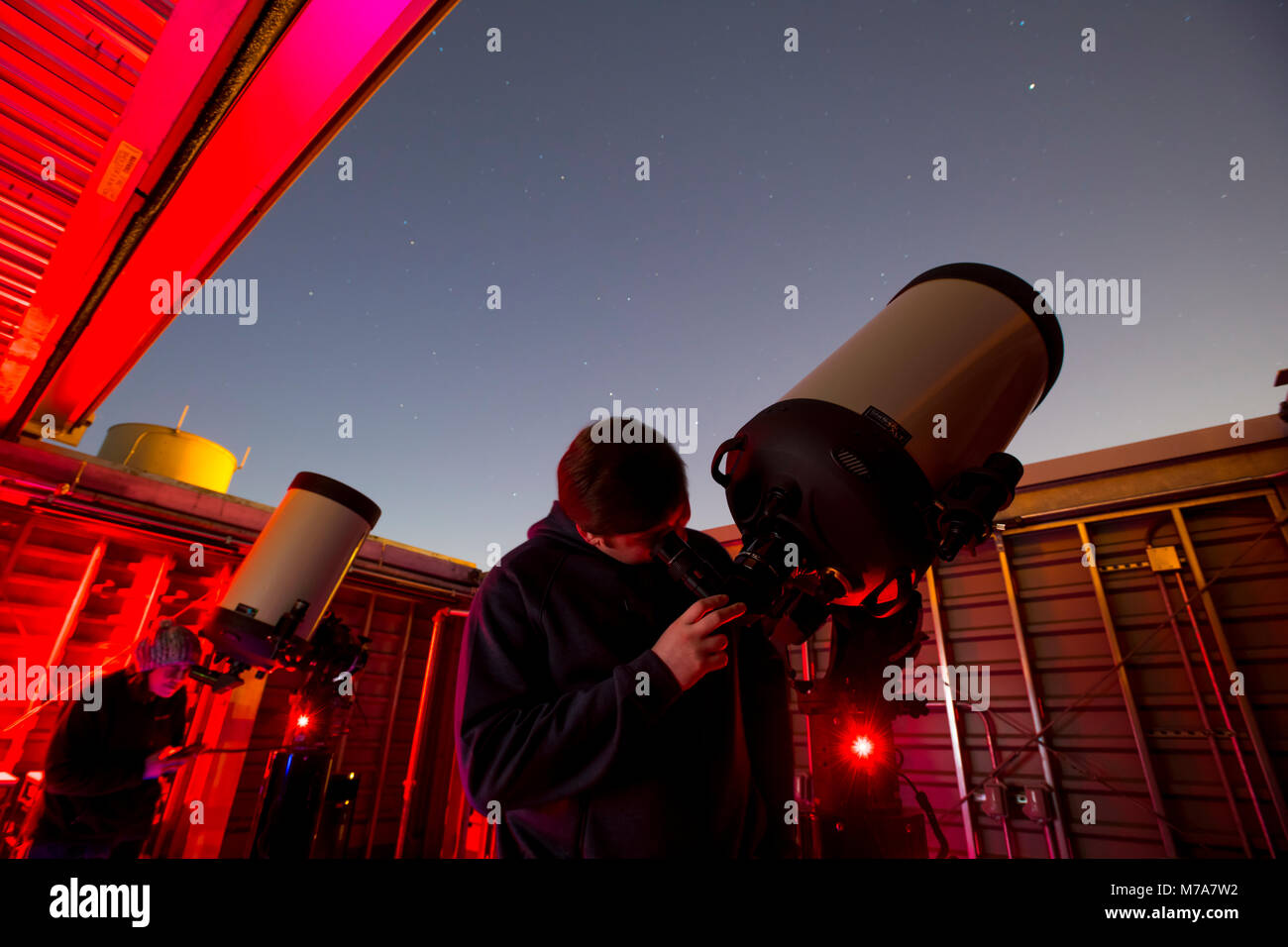 Amateur star gazing at Montgomery College Rockville Maryland observatory using 14 inch reflecting Celestron telescopes - Stock Image