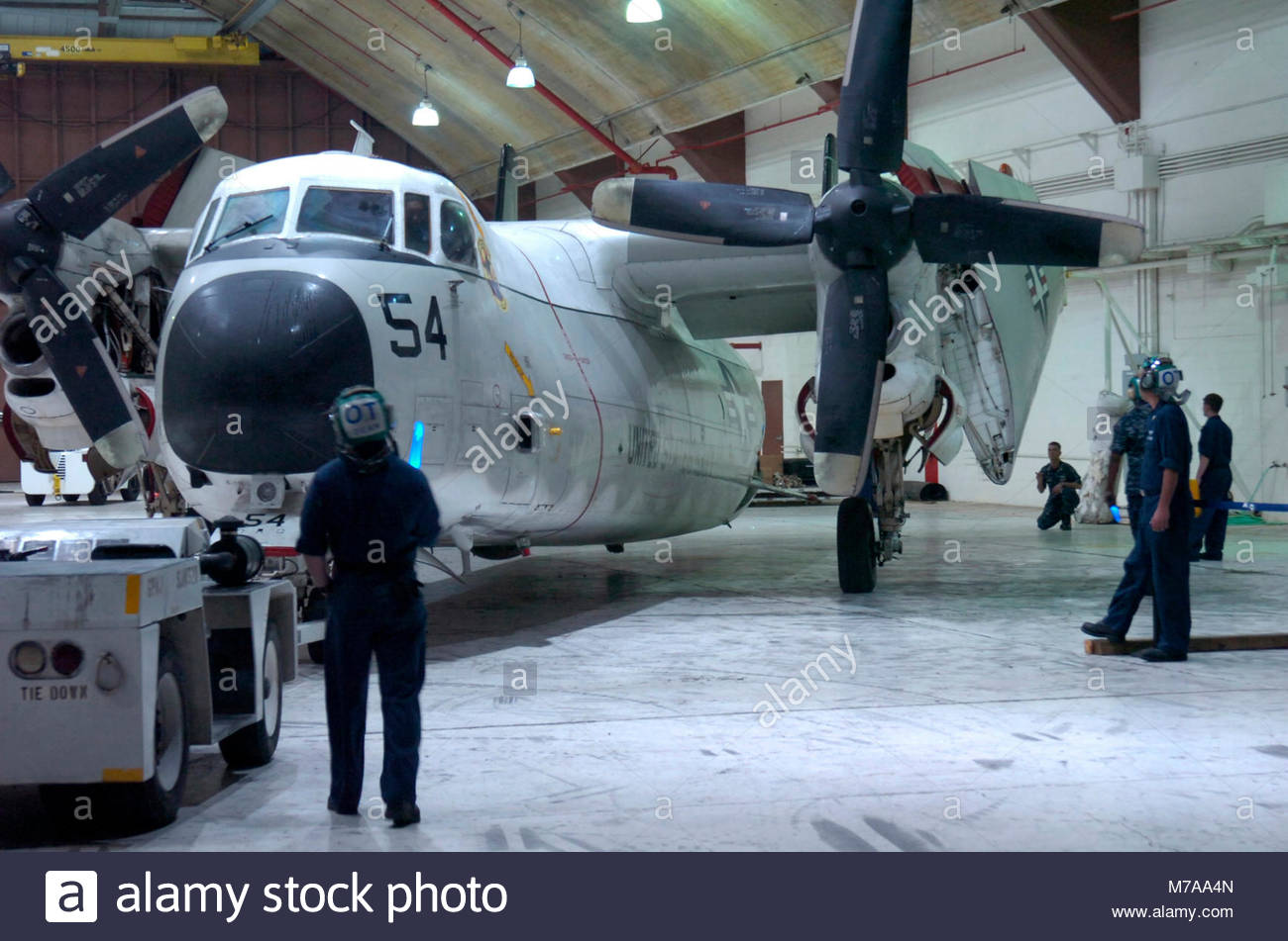 Grumman C-2 Greyhound. Navy Airmen from the Fleet Logistics Support Squadron, home ported at Naval Station Norfolk, Stock Photo