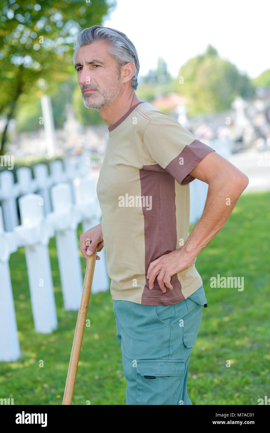 caretaker looking out over army cemetery Stock Photo