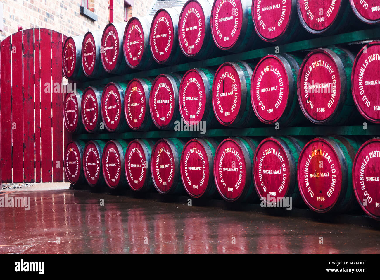 Whisky barrels on the court of the whisky distillery in Bushmills, Northern Ireland - Stock Image