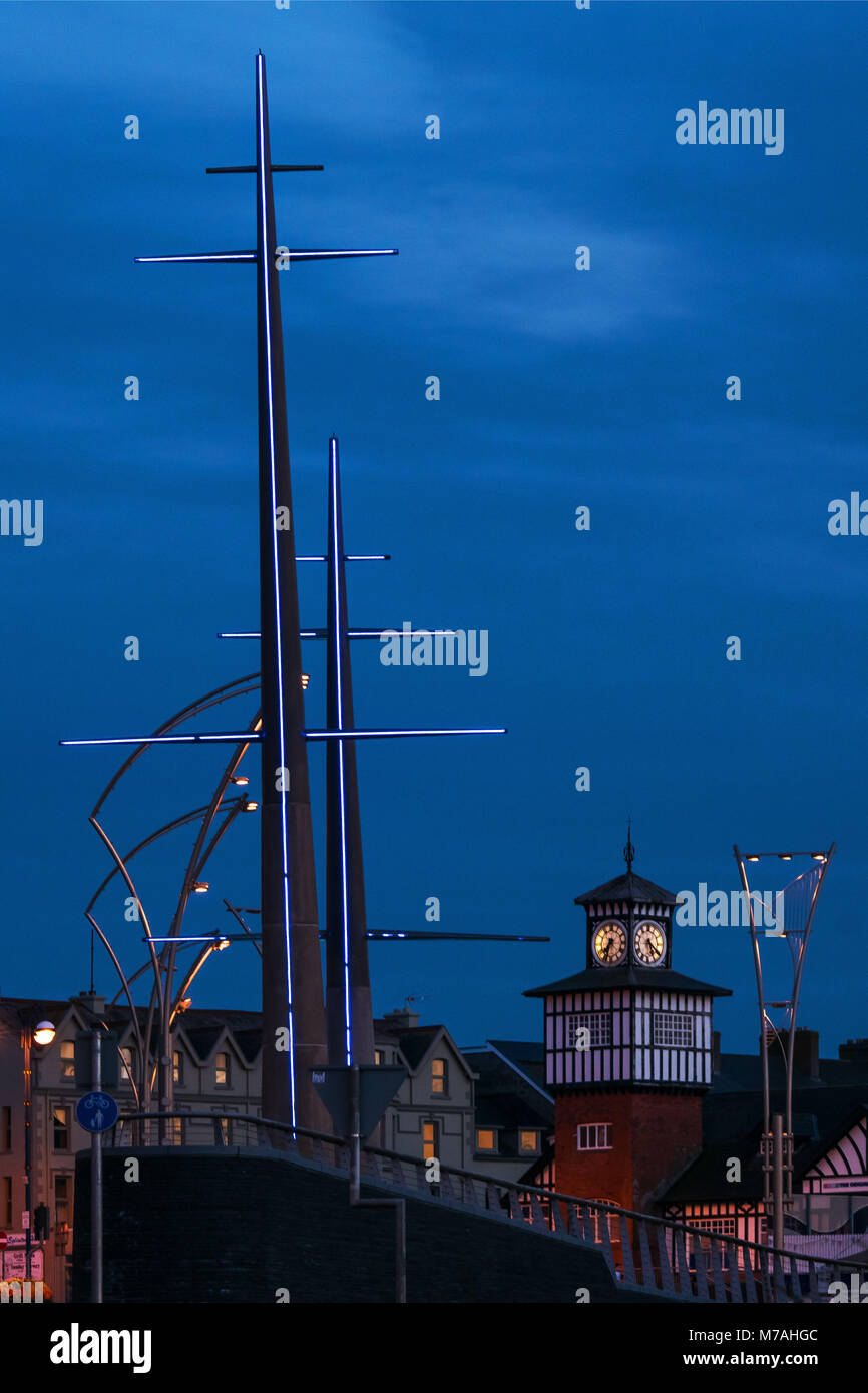 North-Irish provincial town of Portrush at the blue hour, Station Square ' The Masts' - Stock Image