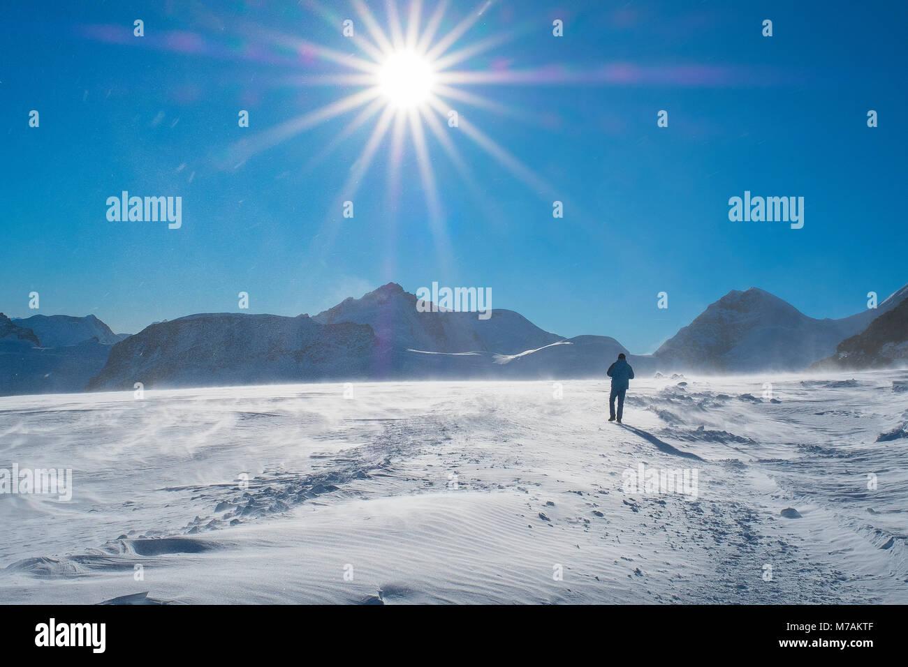 Winter hiker on the Jungfraujoch, Top of Europe, Jungfraujoch, Berner Oberland, canton of Bern, Switzerland - Stock Image