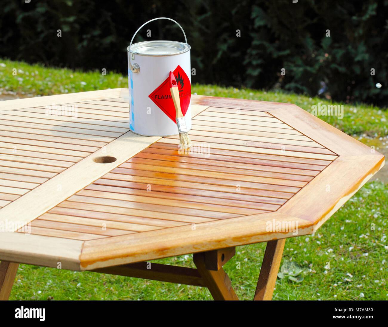 Paint Bucket On Garden Table Stock Photo Alamy
