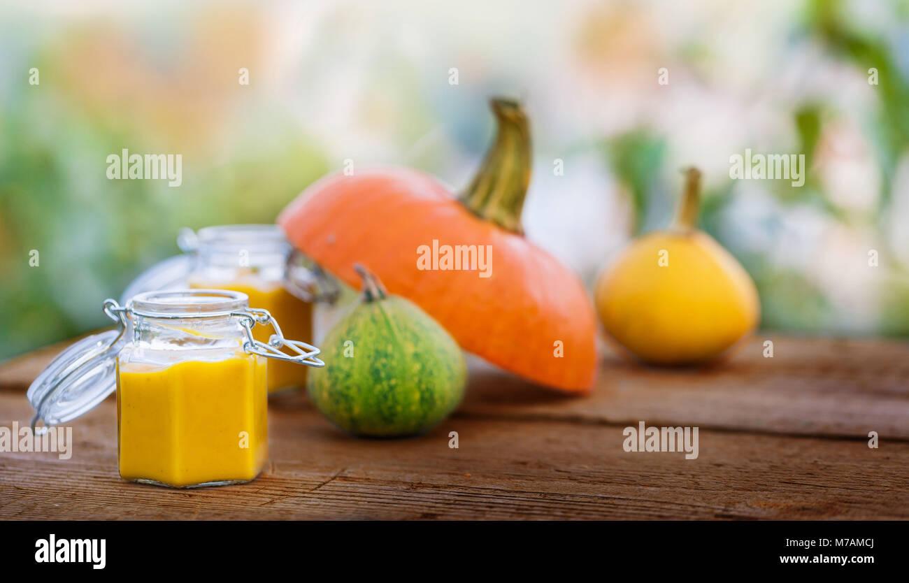 Pumpkin soup in a preserving jar - Stock Image