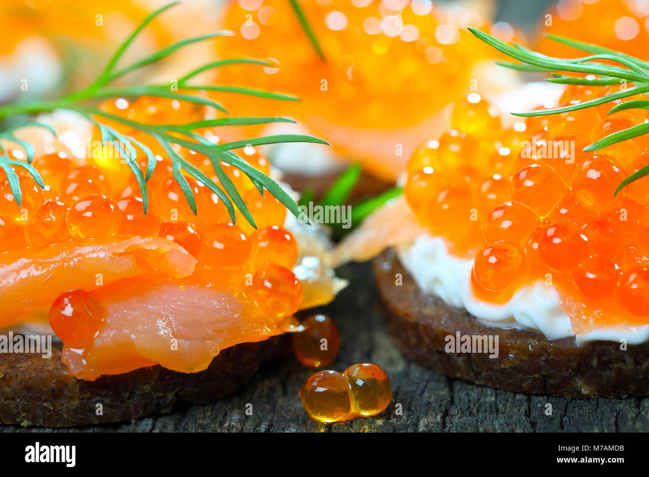 Canapés with salmon and caviar Stock Photo