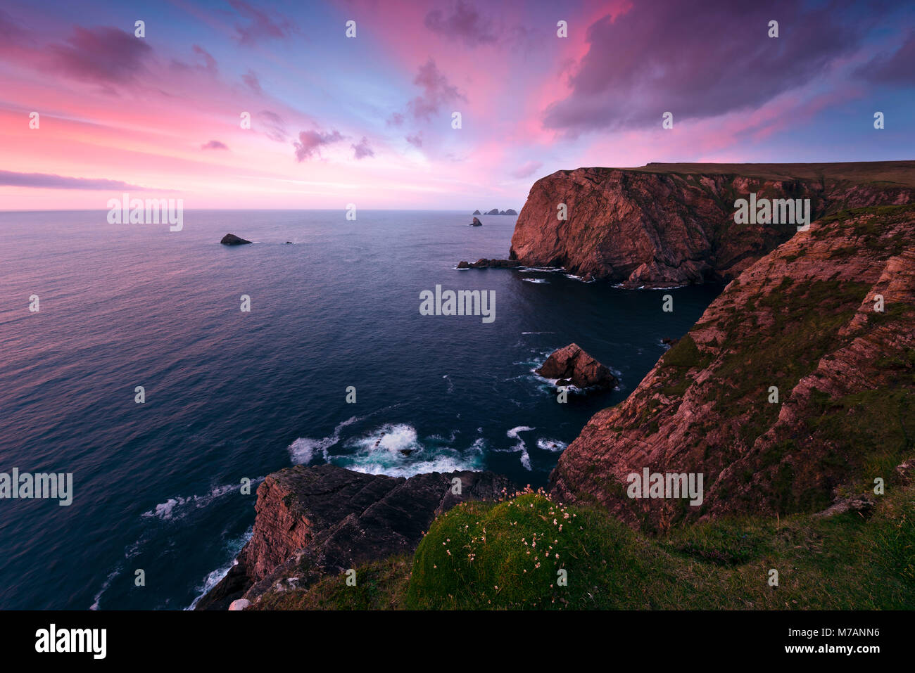 Colored sunset at Benwee Head, County Mayo, Ireland - Stock Image