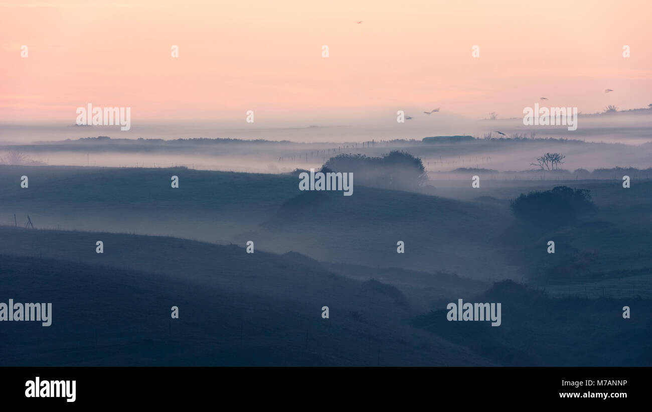 Early morning mist over the backcountry of the coast near Santander, Cantabria, Spain - Stock Image