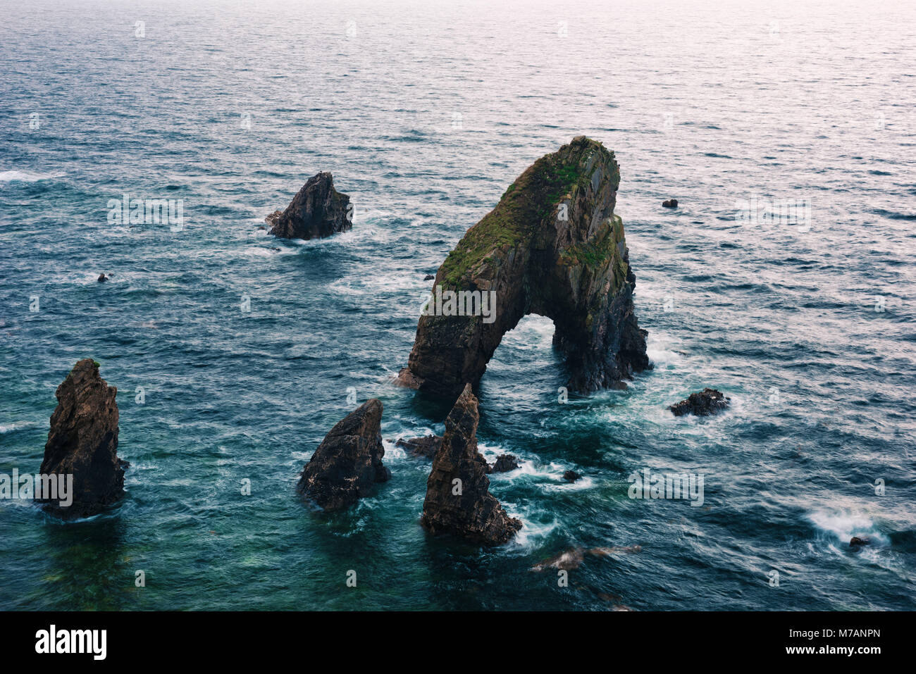 Rock formations 'The Breeches' in the sea, County Mayo, Ireland - Stock Image