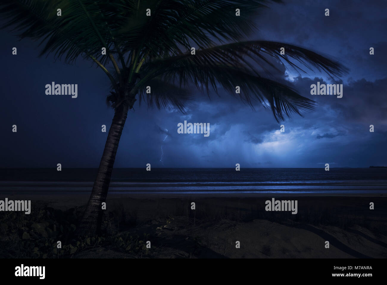 Thunderstorm with lightning over the sea at Coco Beach, Caribbean island Puerto Rico Stock Photo