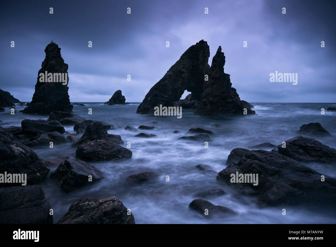 Rock formations 'The Breeches', Crohy Head, County Mayo, Ireland, daybreak, Blue Hour, - Stock Image