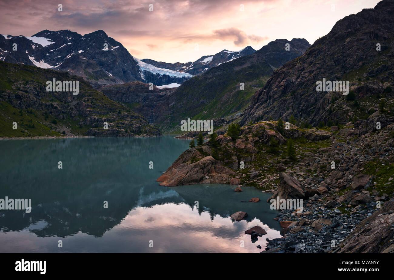 Bacino di Alpe Gera with Sasso Rosso and Fellaria glacier in Val Malenco, Bernina group, Sondrio, Lombardy, Italy - Stock Image