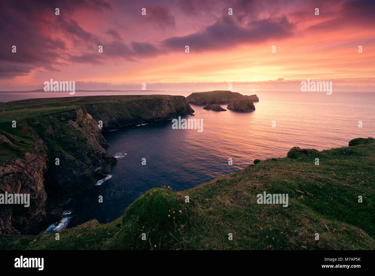 red sunset at the cliffs of Benwee Head, County Mayo, Ireland - Stock Image