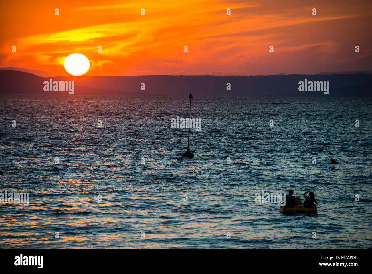 Sunset over the Amur river in Vladivostok, Russia - Stock Image
