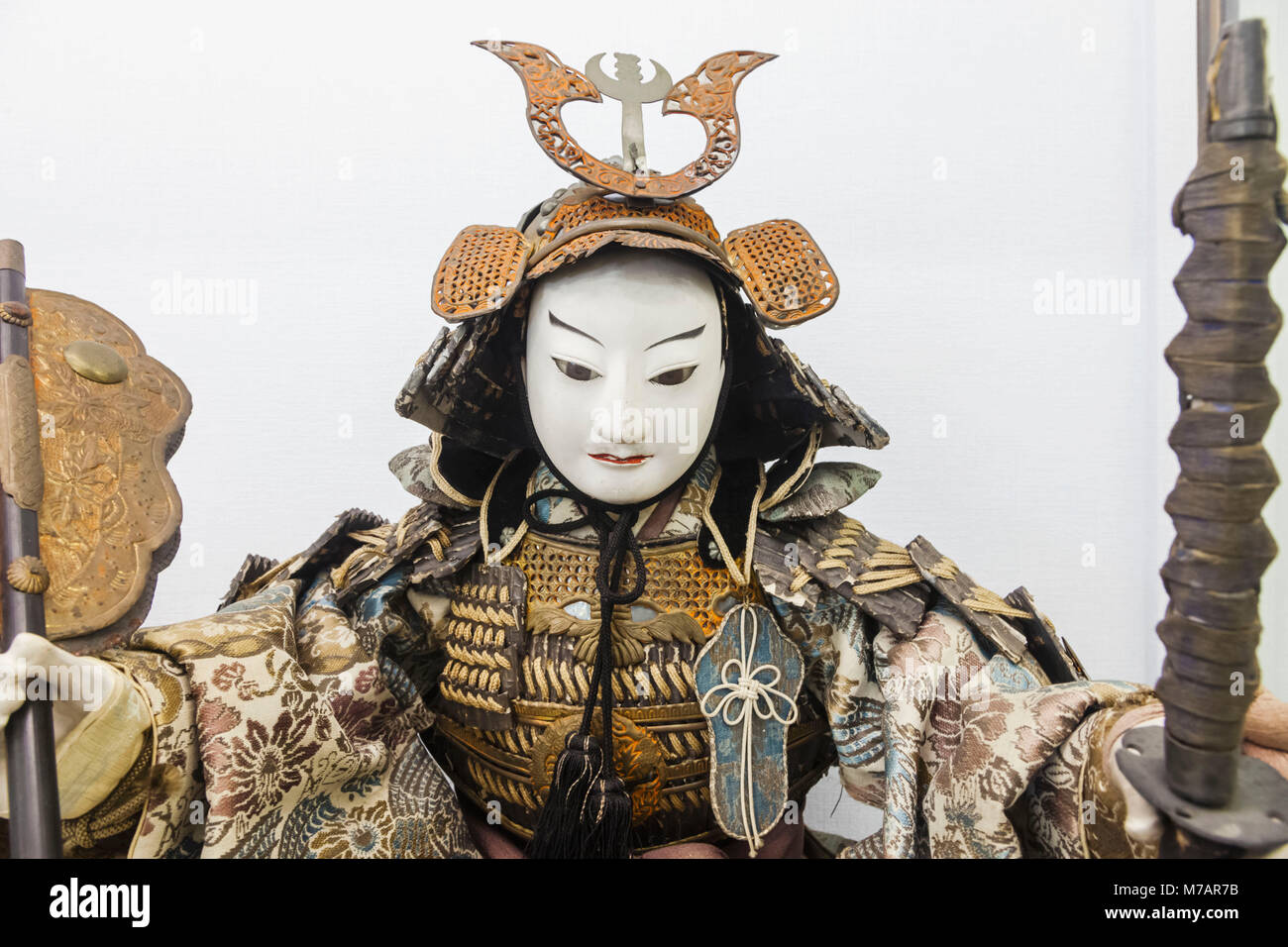Japan, Honshu, Shizuoka Prefecture, Atami, Atami Castle, Exhibit of Japanese Doll Dressed in Warrior Costume - Stock Image