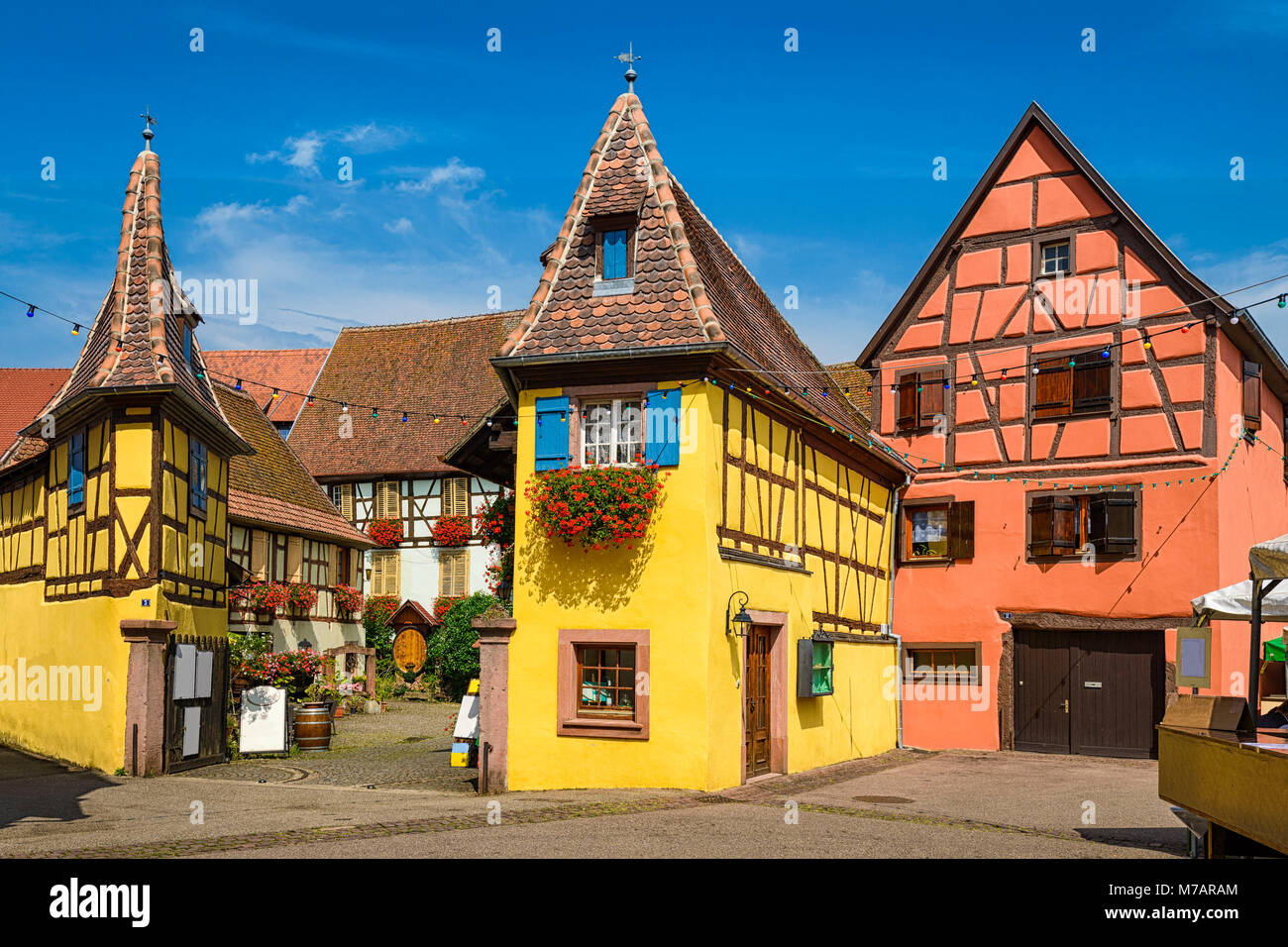 Medieval buidings in Eguisheim near Colmar, France - Stock Image