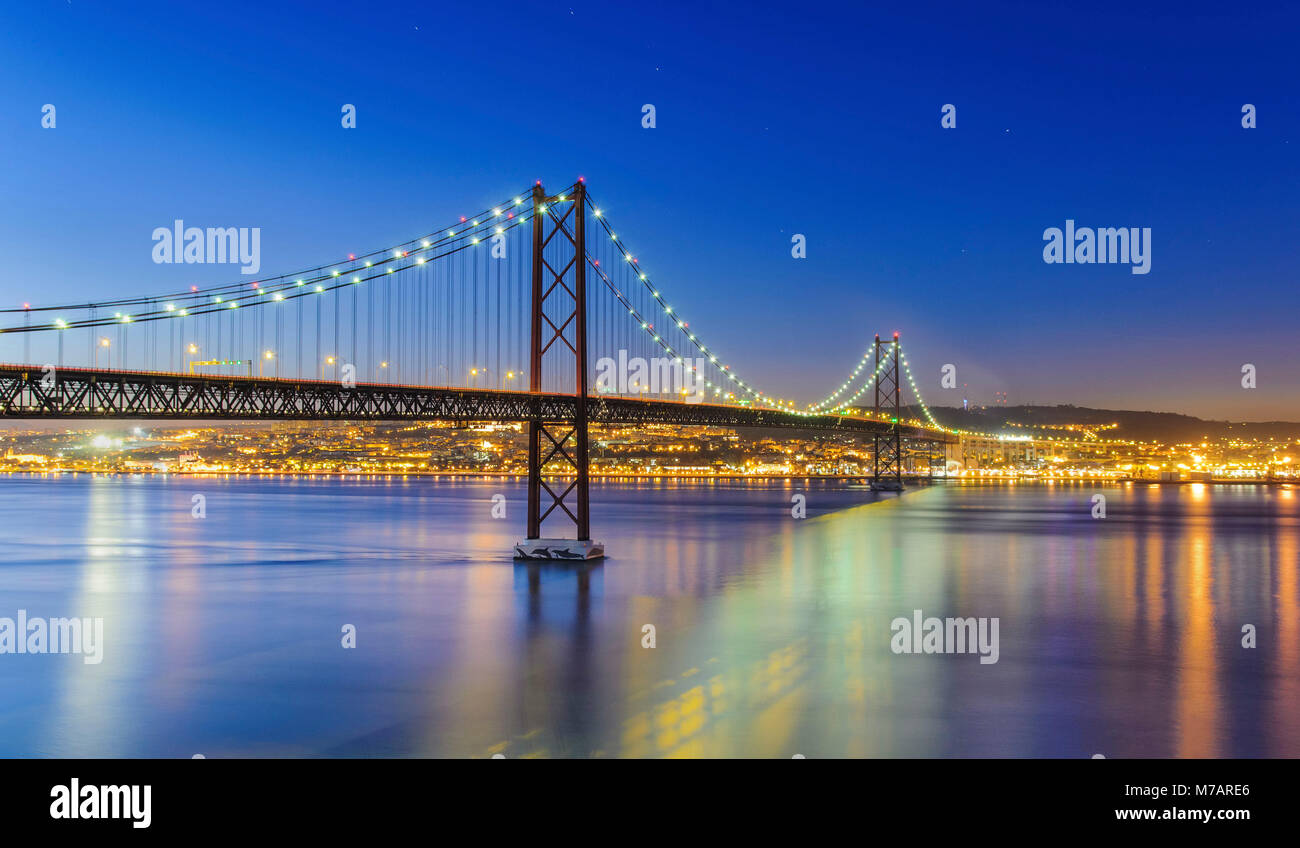 Night view of Lisbon and of the 25 de Abril Bridge, Portugal Stock Photo