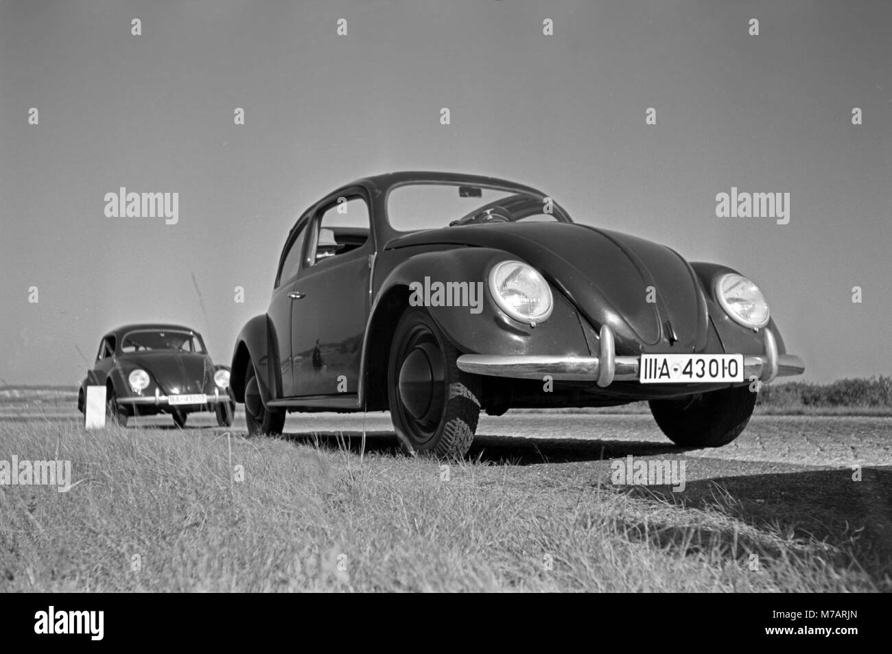 Two models of the Volkswagen beetle, or KdF car, with open and closed roof near the test track near Wolfsburg, Germany - Stock Image