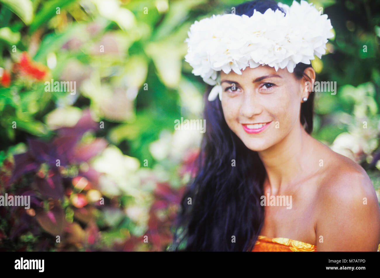 Portrait of a young woman smiling, Hawaii, USA - Stock Image
