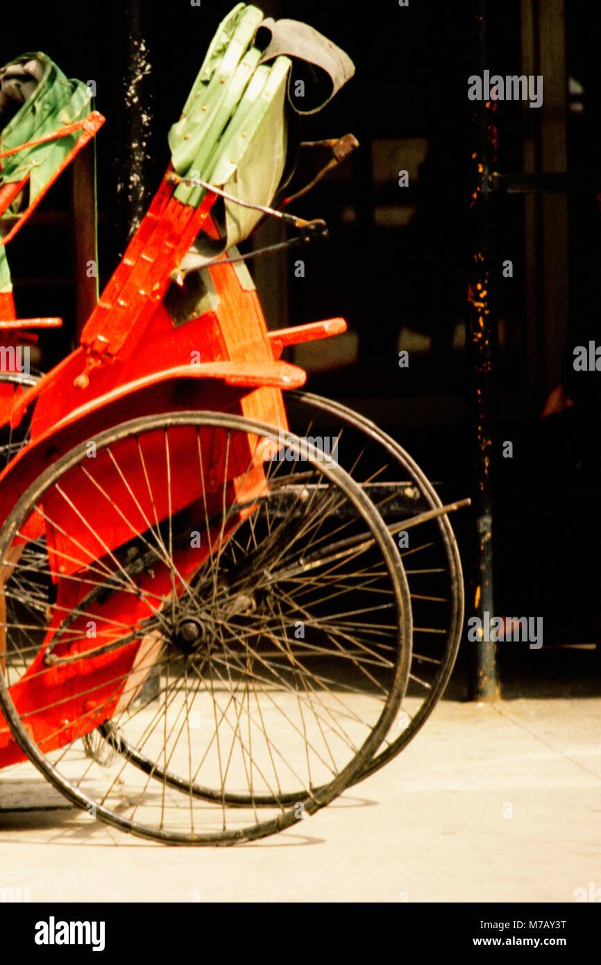 Two-wheeled rickshaw on the road, Hong Kong, China - Stock Image