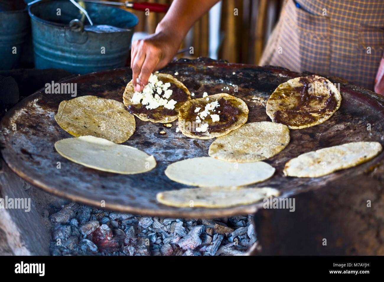 Chef Preparing Tortilla In A Kitchen, Santo Tomas Jalieza, Oaxaca State,  Mexico