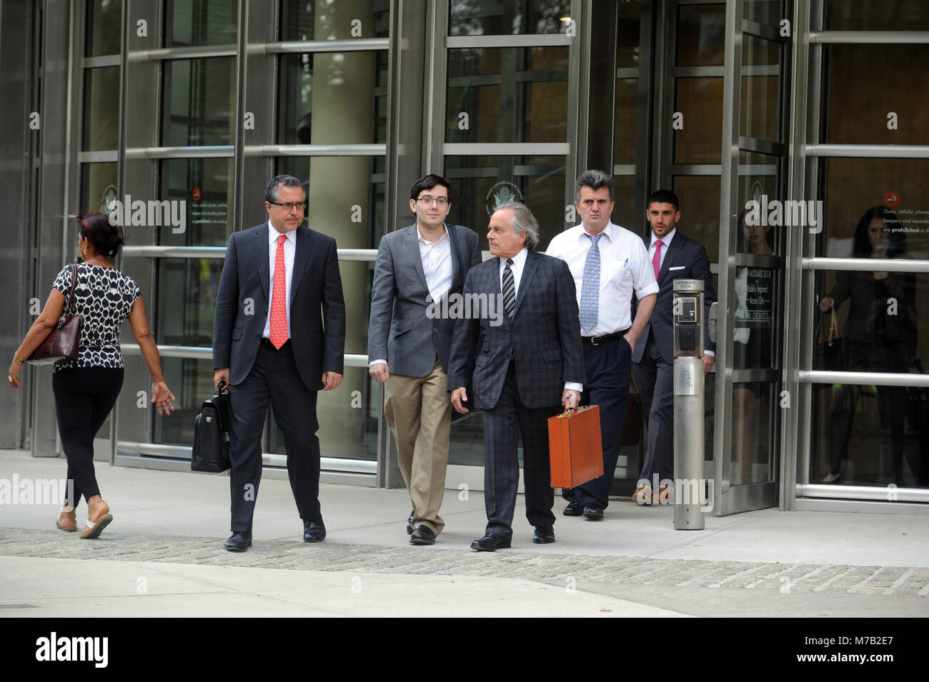 NEW YORK, NY - AUGUST 04: Martin Shkreli, former chief executive officer of Turing Pharmaceuticals AG, center, pauses - Stock Image
