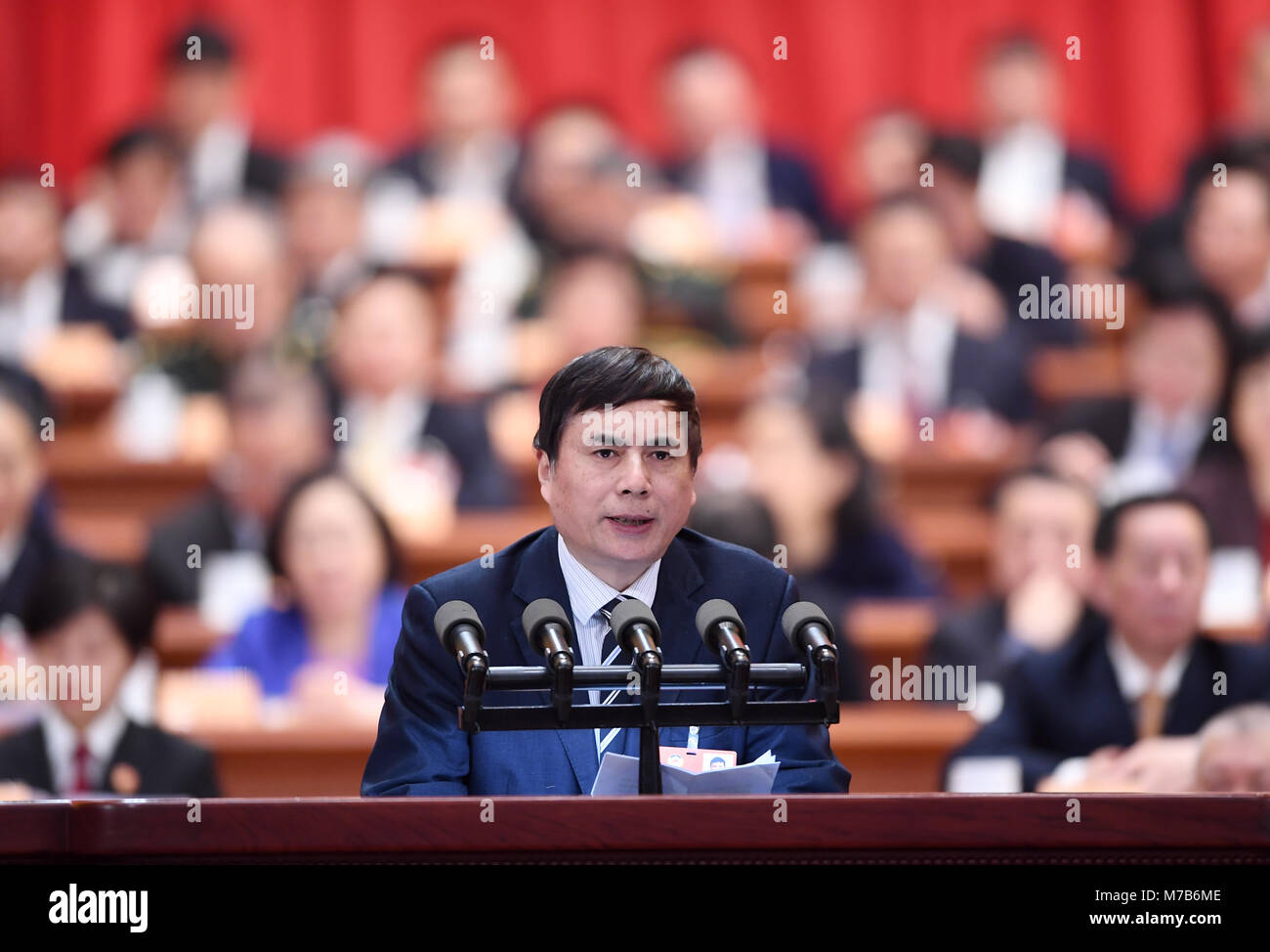Beijing, China. 10th Mar, 2018. On behalf of the Taiwan Democratic Self-Government League Central Committee, Yang - Stock Image