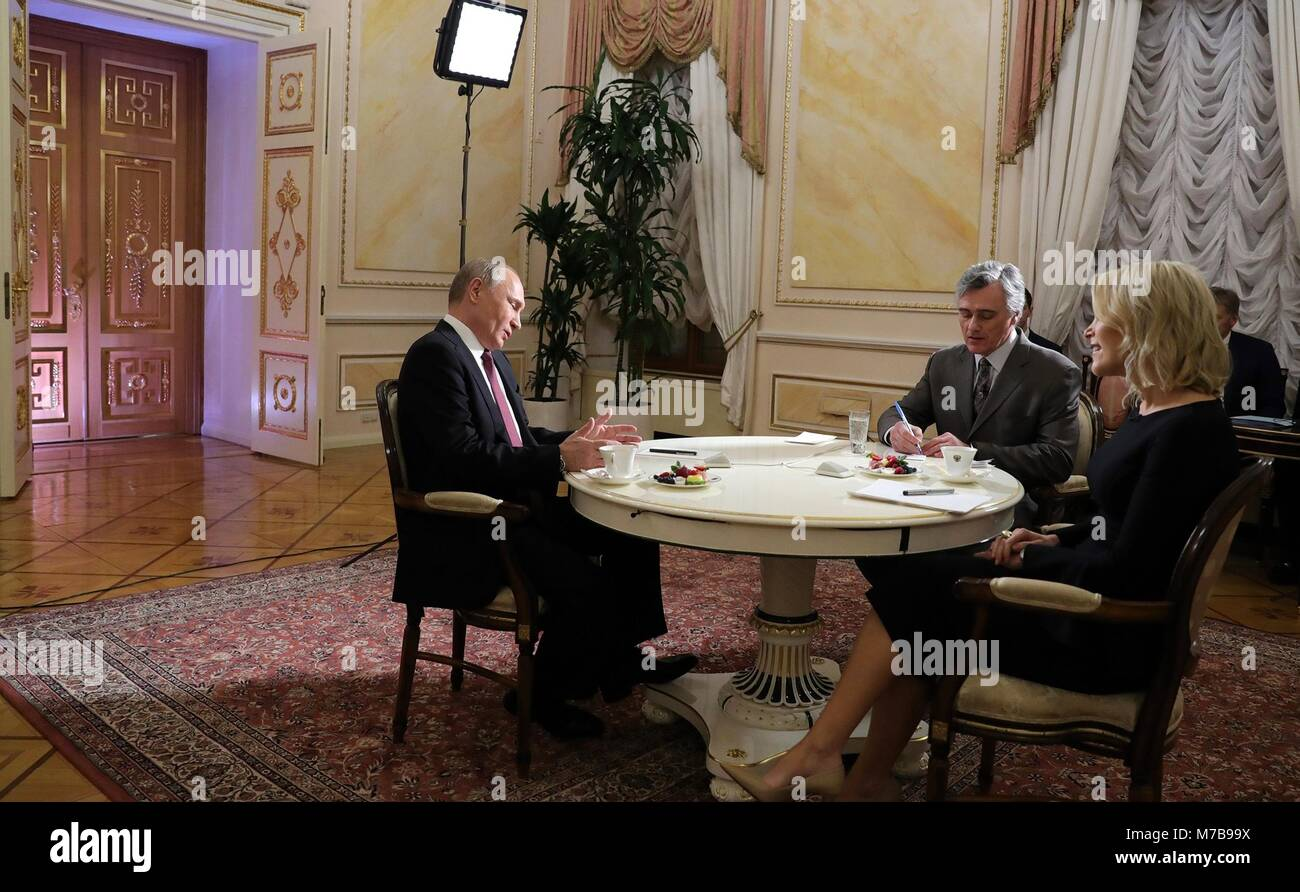 Russian President Vladimir Putin during a television interview with NBC reporter Megyn Kelly, right, at the Kremlin - Stock Image