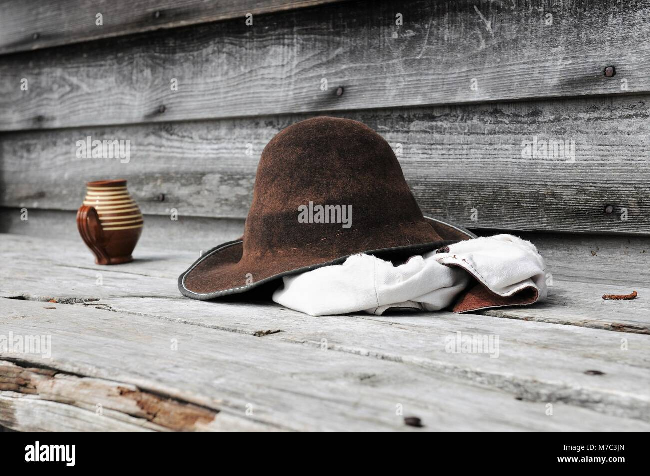 Hat, white vest and mug sitting on the dock at the Jamestown Settlement in Virginia - Stock Image