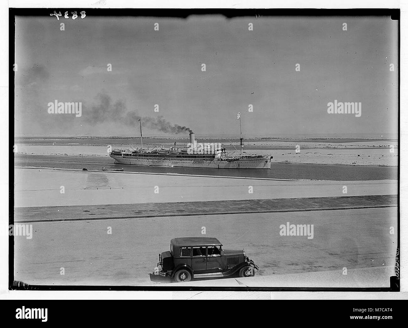 Egypt. Ismailia. Ship passing through the canal. Taken from monum(ent) terrace, closer LOC matpc.03809 - Stock Image