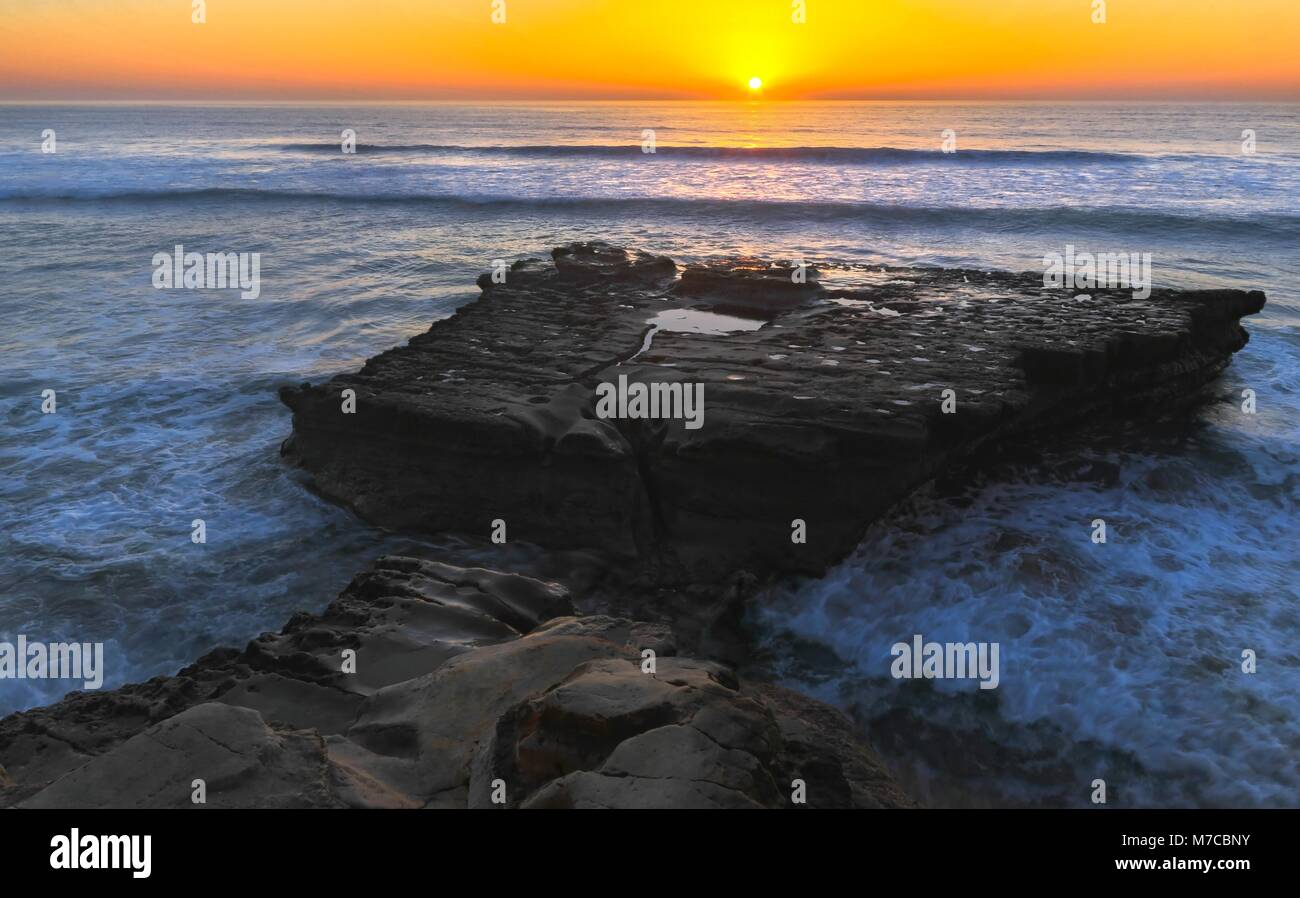 Flat Rock Formation and Distant Pacific Ocean Scenic Sunset Landscape on Torrey Pines State Beach north of San Diego - Stock Image