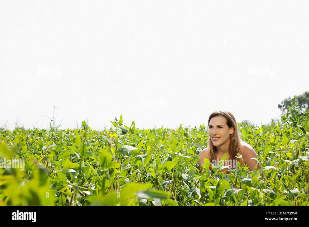 Woman enjoying in a field Stock Photo