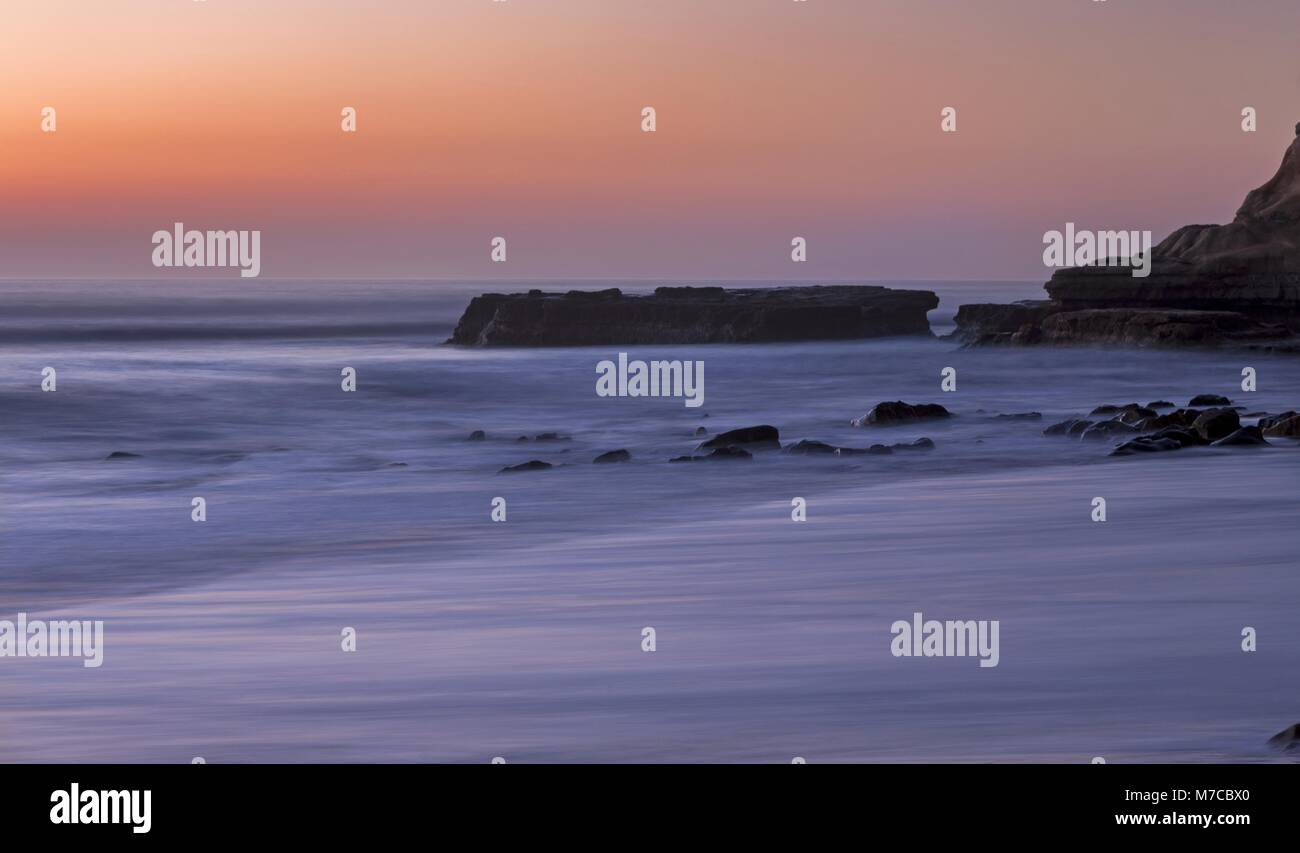 Scenic Twilight Sunset Landscape View of Flat Rock and Pacific Ocean in Torrey Pines State Beach on Southern California - Stock Image