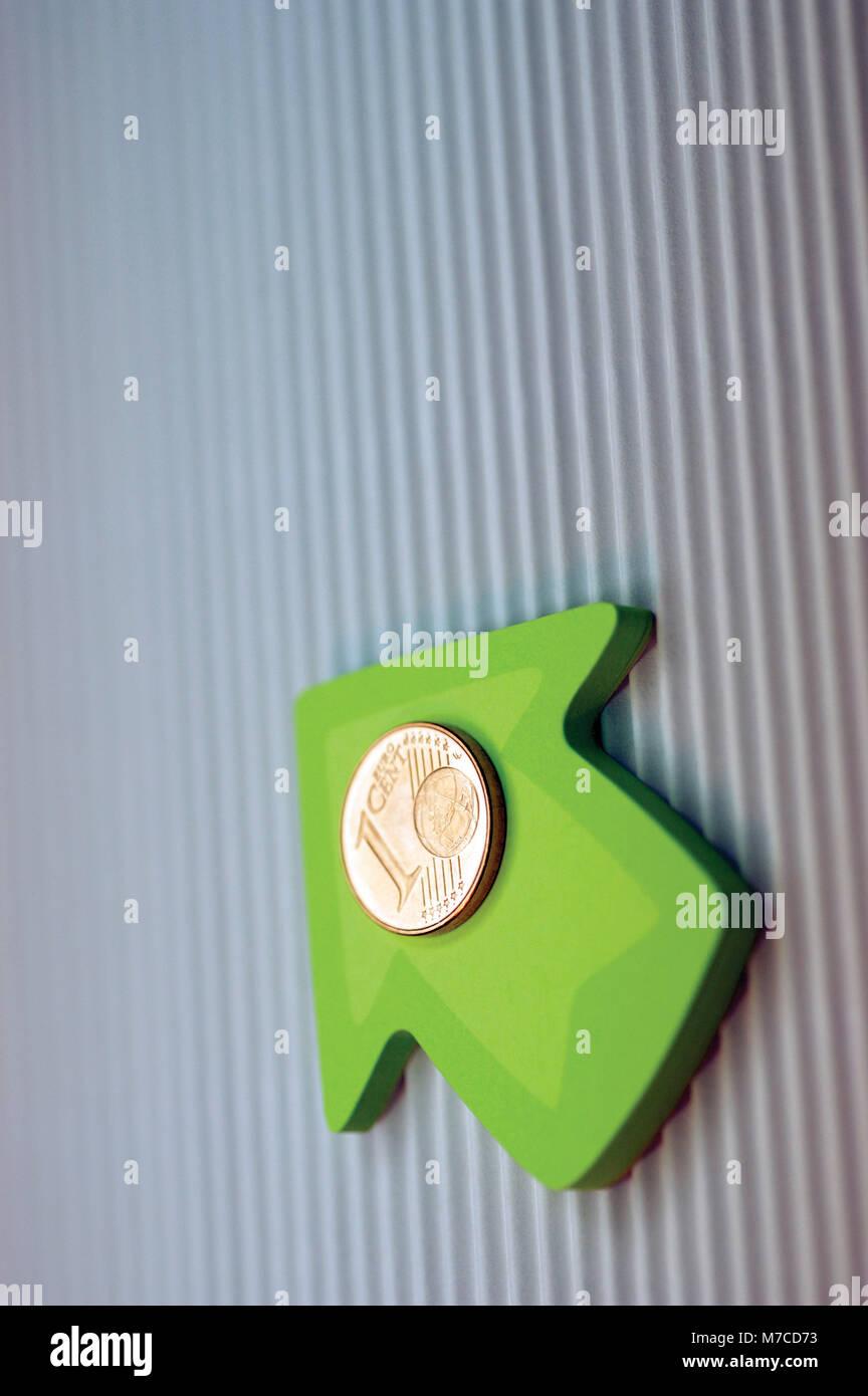 Close-up of one Euro cent coin on an arrow - Stock Image