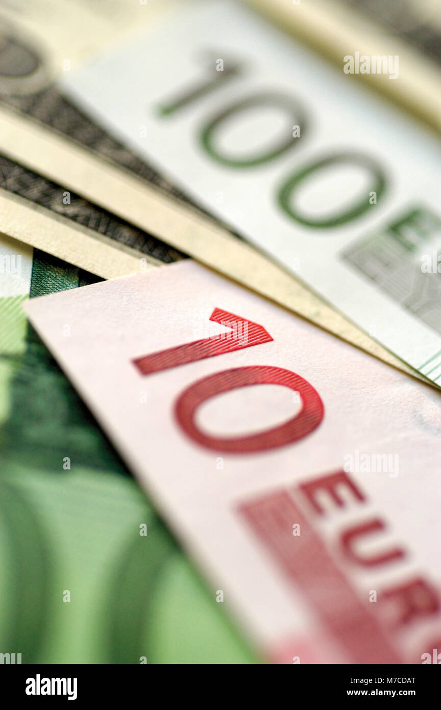 Close-up of a hundred Euro banknote and a ten Euro banknote - Stock Image