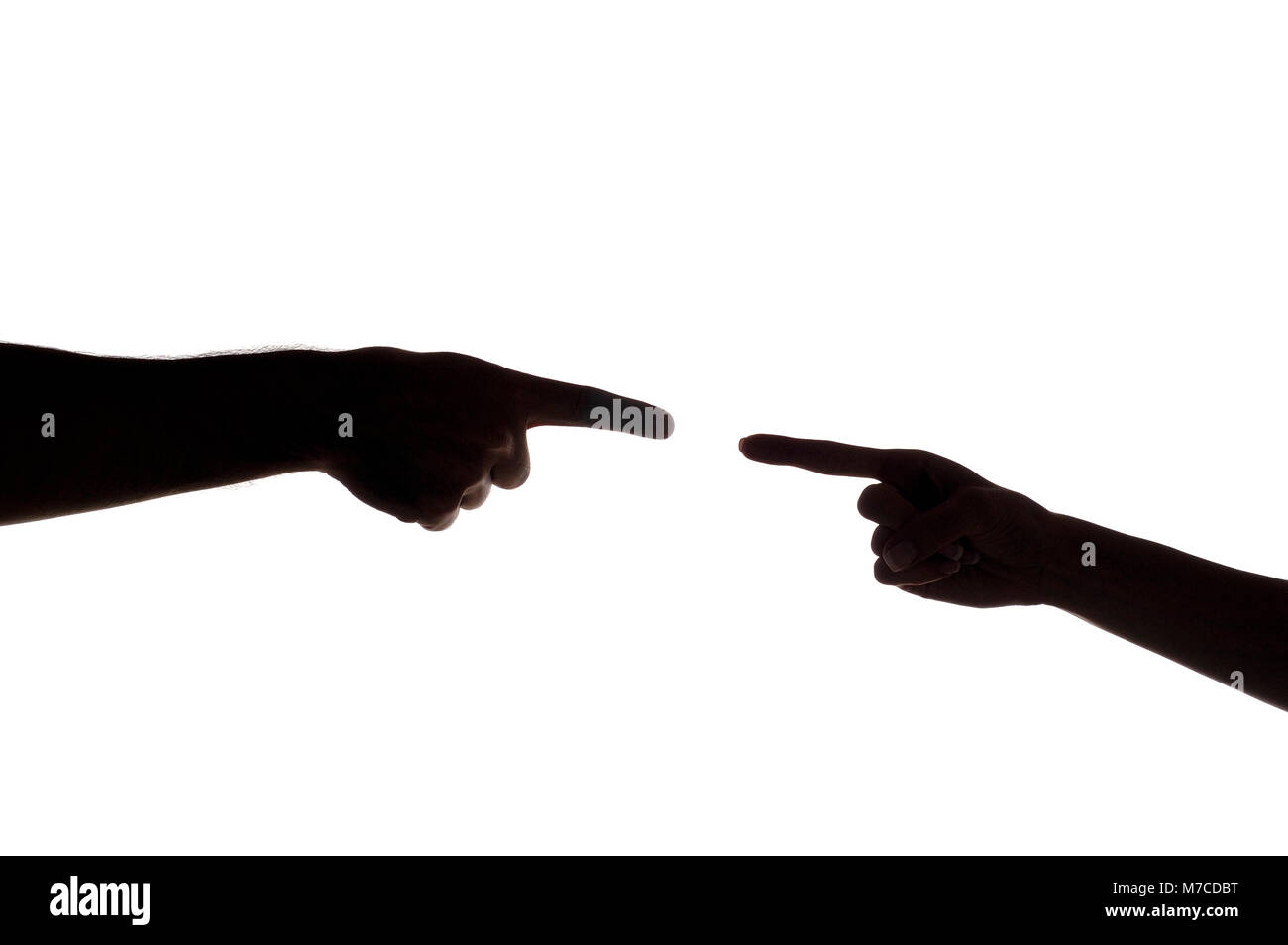 Close-up of a man's finger pointing to a woman's finger - Stock Image
