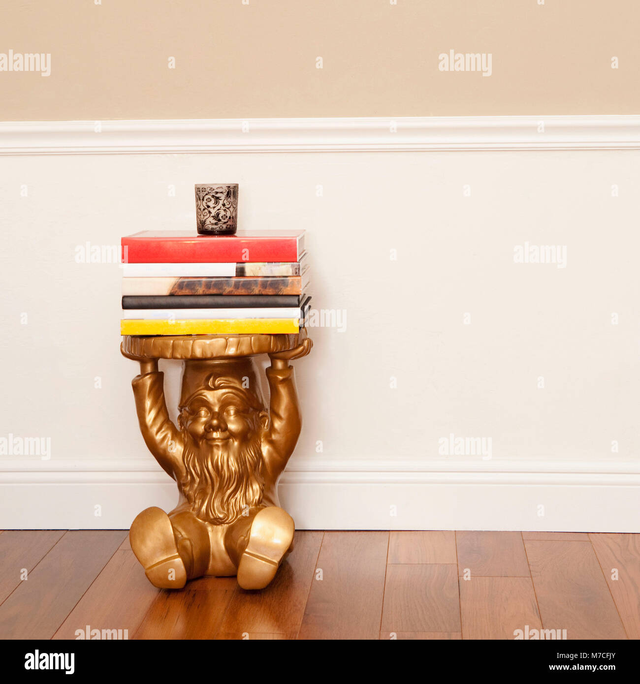 Stack of books on a stool - Stock Image