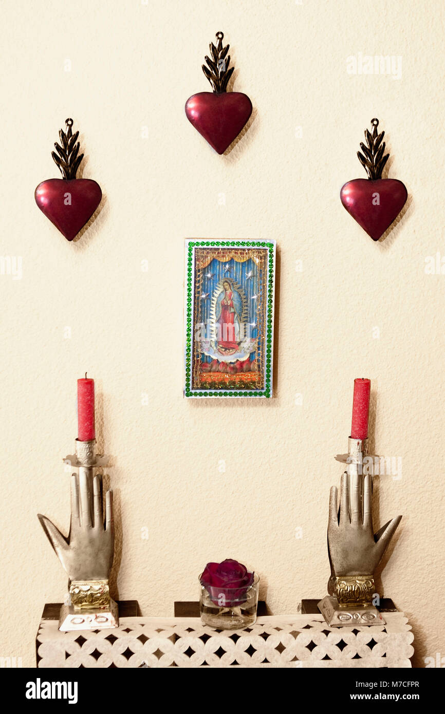 Candles with showpieces on an altar - Stock Image